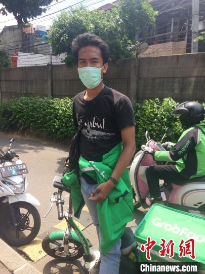 全球战疫:疫情下的印尼雅加达网约摩托司机(图)