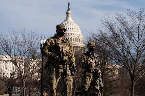 SUN:阴谋论组织传特朗普3月4日再任总统 美军严防死守国会大厦防恐袭